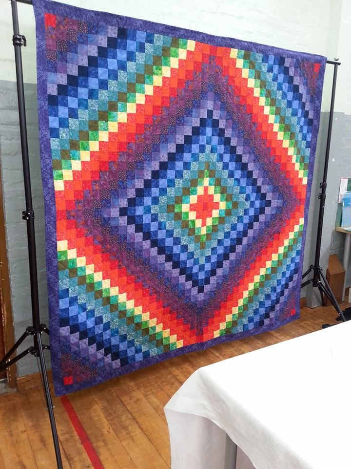 Rainbow Round The World Quilt by Bonnie McKerracher